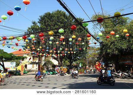 Hoi An, Vietnam - February 15, 2018: View On A Busy Crossroad In A Center Of City With Motorcyclists