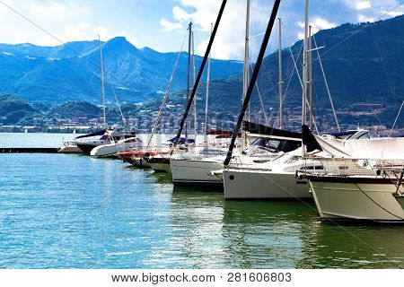 Beautiful View Of The Coast Of Italy. Beautiful View From The Boats At The Shore. Lake With Boats Al