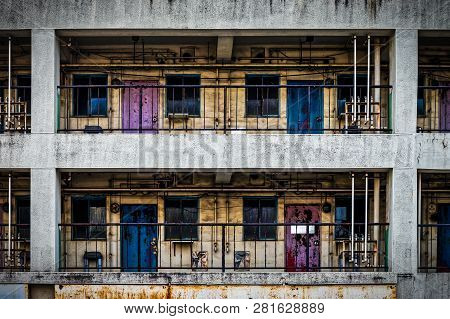 The Colorful Backside Of A Building With Pipes, Red And Blue Doors, And Yellow Paint In Yokosuka, Ja
