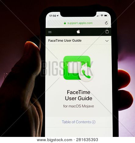 Paris, France - Jan 30, 2018: Man Holding Apple Iphone Xs With Facetime Icon And User Guide On The S