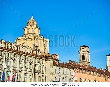 Turin, Italy - December 31, 2018. Dome Of The Real Chiesa Di San Lorenzo Church And The Bell Tower O