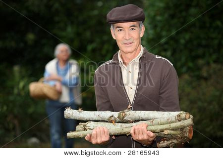 Man collecting wood