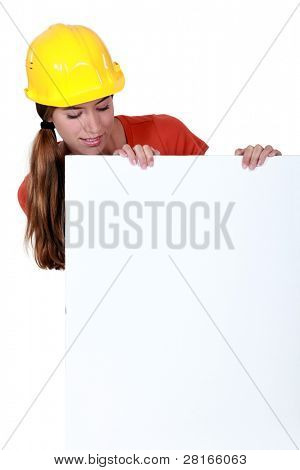 Female laborer with a blank board