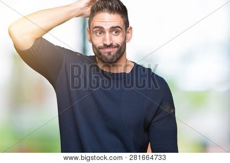 Young handsome man wearing sweater over isolated background confuse and wonder about question. Uncertain with doubt, thinking with hand on head. Pensive concept.