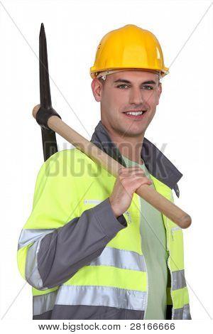 Tradesman carrying a pickaxe