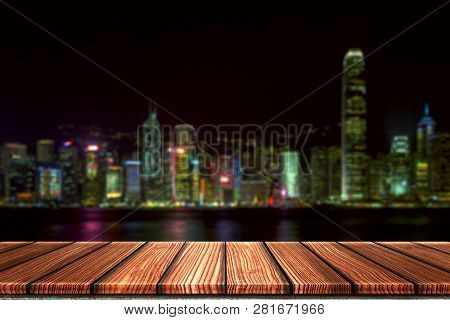 Empty Wooden Board Top Table In Front Of Night City Blurred Background. Perspective Wood In Blurred