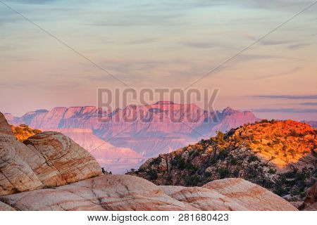 Zion National Park. Beautiful unspiring natural landscapes. Peak in Zion Park at sunset. Living coral color background.