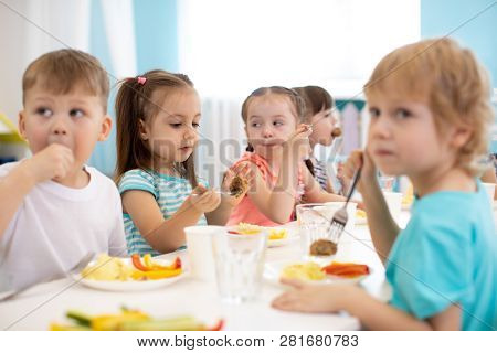 Group Of Kindergarten Children Have Lunch In Daycare
