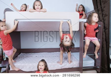 Many Clone Little Girls On Bund Bed In Child Room In Domestic Life. Identical Child Crowd. Child Omn