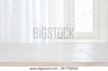 Wood Table Top On Defocused Pastel Background Of Curtained Window