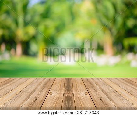Wooden Board Empty Table In Front Of Blurred Background. Perspective Grey Wood Over Blur Trees In Fo