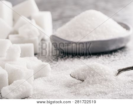 Sugar Background. Sugar Cubes, Granulated Sugar In Spoon And Plate. White Sugar On Gray Galvanized I