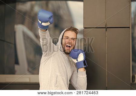 Winner Takes It All. Man On Smiling Face Posing With Boxing Gloves As Winner, Urban Background. Spor