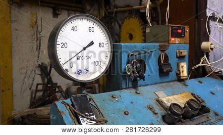 Pressure Gauge On Control Panel. Pressure Gauge Or Pressure Indicator Stands On Old Blue Control Pan
