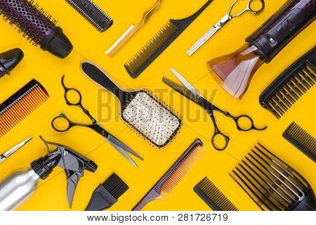 Top View Of Hairdresser Tools And Accessories On Yellow Background