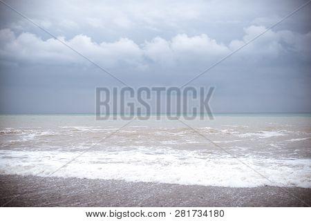 Sea Wave Surf. Sea Waves With A Lot Of Sea Foam. Beautiful Blue Waves With A Lot Of Sea And Clouds O