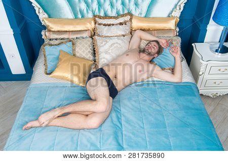 He Needs More Sleep. Sleeping Man In Morning. Handsome Man Having Sleep In Bedroom. Sexy Man Sleepin