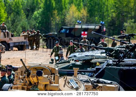 Nato Soldiers And Military Equipment In Latvia. International Military Training