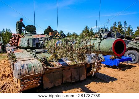 Tanks And Military Vehicles. Nato Soldiers And Military Equipment In Latvia. International Military