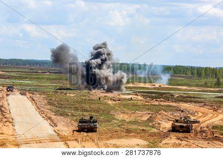 Explosion, Smoke And Military Vehicles. International Military Training