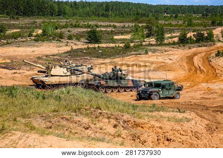 Tanks And Armored Vehicles In Latvia. International Military Training