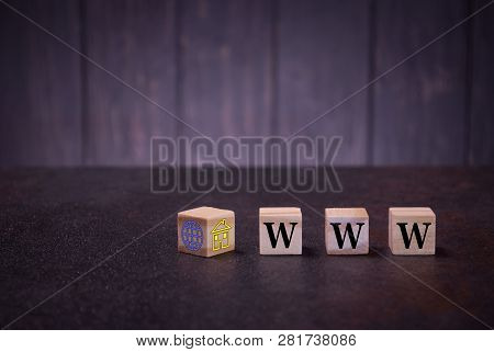 The Letters Abbreviation Www On Wooden Cubes, On A Dark Background, Light Wooden Cubes Signs, Symbol