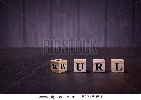 The Letters Abbreviation Url Www On Wooden Cubes, On A Dark Background, Light Wooden Cubes Signs, Sy