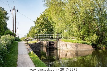 English Canal Lock And Tow Path, Lee Valley, England. A Tow Path And Canal Lock On The River Lee Nav