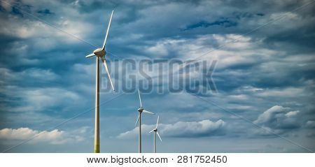 Picture Of Wind Farm Generators In The Yellow Field