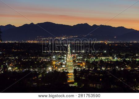 Los Angeles, California, USA - January 28, 2019:  Predawn view of Devonshire Street in the San Fernando Valley.  The San Gabriel Mountains are in background.
