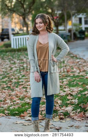 Young Brunette Model poses in fall colors