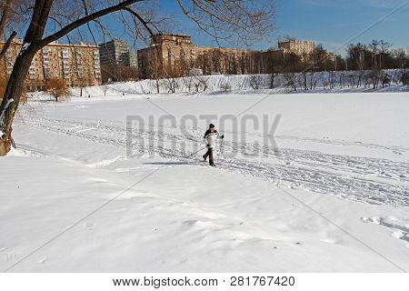 Moscow, Russia - March 06, 2018: A Man Skiing On A Frozen Pond In The Park