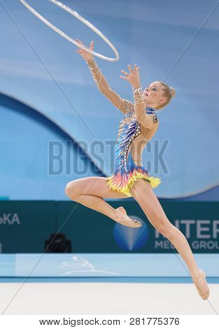 KIEV, UKRAINE - AUGUST 28, 2013: Laura Jung, Germany performs with hoop during 32nd Rhythmic Gymnastics World Championships. The event is held in Palace of Sport