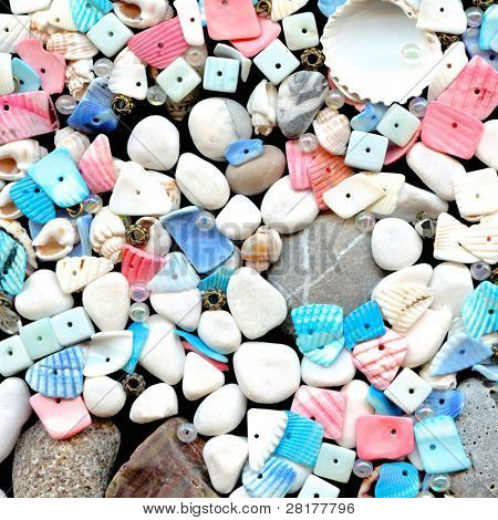 Close-up beautiful seashells with beads on black background