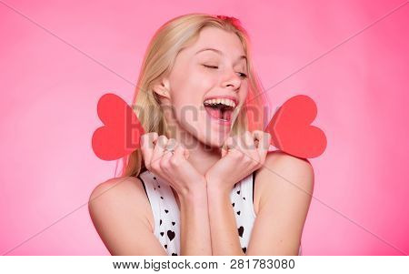 Celebrate Valentines Day. Girl Romantic Mood Dream About Date. Woman Hold Heart Valentines Decoratio