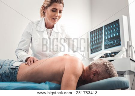 Contended Blonde-haired Massage Therapist Loving Her Work