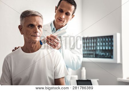 Man In White Shirt Coming To Professional Chiropractor