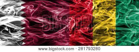 Qatar Vs Guinea, Guinean Smoke Flags Placed Side By Side. United Arab Emirates. Uae