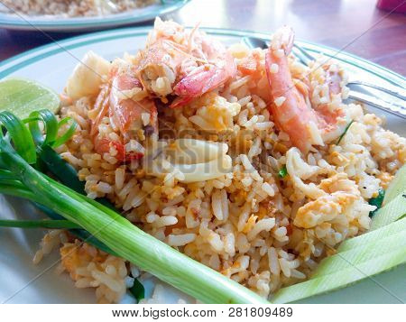 Thai Food In The Dish. Fried Rice With Shrimp And Squid.
