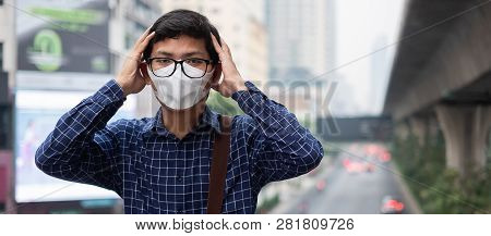 Young Asian Man Wearing N95 Respiratory Mask Protect And Filter Pm2.5 (particulate Matter) Against T