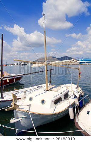 Alcudia Majorca port with llaut boats in marina on Mallorca island from Balearic Spain
