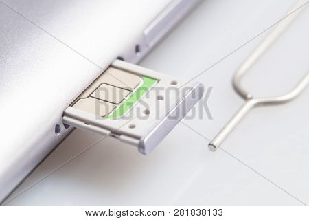 Nano Sim Card Extract From Sim Card Adaptor On White Screen Glass Background