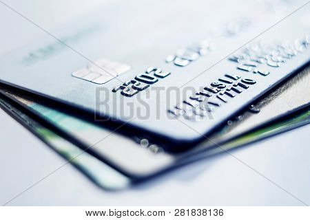 Credit Cards Stacked On Light Background. Debit Bank Cards On A Light Background