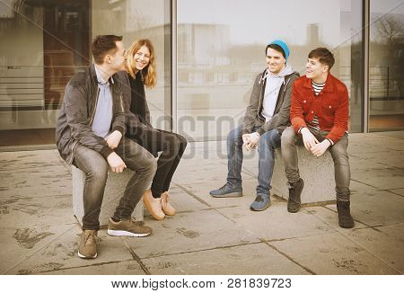Group Of Young Teenage Friends Talking And Laughing Together - Candid Real People With Vintage Filte