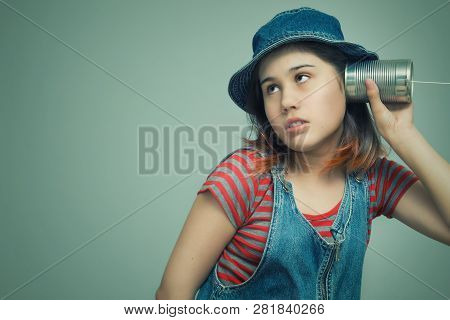 A Girl Attached A Telephone From A Tin Can To His Ear