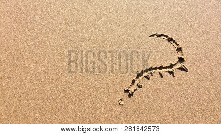 question mark drawn in the sand, a symbol of mystery and riddles poster