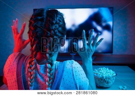 Watching A Horror Movie With Popcorn, Colorful Colored Background. Movies, Movies, Horror Stories. S