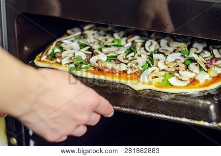 Process Of Making Pizza. Italian Pepperoni Pizza With Mushrooms, Ruccola, Tomatoes, Mozzarella, Garl