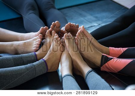 Group Feet Of Fitness People Yoga In Gym . Join Foot Together