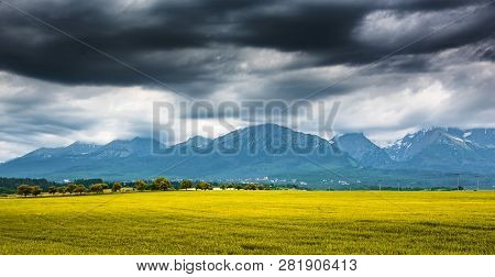 Beautiful Mountain Landscape. Rocky Mountains Against The Dark Sky And Sunlight. Tatra Mountains.